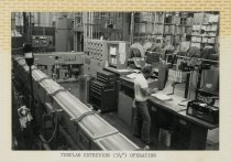 "Image of 2015.029.002A - Raychem Operations Photograph, Tubular Extrusion (3 1/2"") Operation, c. 1960s-1970s"