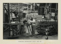 """Image of 2015.029.002B - Raychem Operations Photograph, Tubular Extrusion (3/12"""") Set Up, c. 1960s-1970s"""
