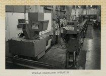 Image of 2015.029.002C - Raychem Operations Photograph, Tubular Granulator Operation, c. 1960s-1970s