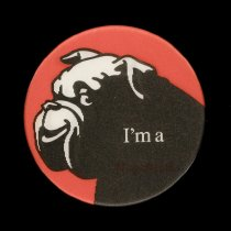 """Image of 2016.015.002.52 - Raychem Corporation Tough Customer Button, c. 1980s. Promotional lenticular pinback button produced by the Raychem Corporation. The 3"""" diameter button shows a red and black graphic of a bulldog that winks when the button is tilted back and forth. Text appears at lower right that changes from """"I'm a"""" to """" 'tough customer.'  /  Raychem."""""""