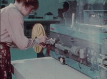 "Image of 2016.015.003.16 - LAR System Equipment, November 27, 1979. One 16mm color film, approximately 250' and 7 minutes without sound. The film shows several female operators using industrial equipment to assemble devices. ""ORIGINAL  /  Do Not Project"" printed on film leader along with handwritten text in black ink that reads, ""Raychem Machines  Heads  Ron Sloan."" Originally stored in a brown metal film canister, 7.125"" diameter x 1"" with the label, ""LAR SYSTEM EQUIPMENT  /  11-27-79."""