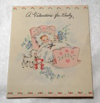 """Image of 2017.008.031.1.8 - Valentine Card to JoAnn Semones, 1946. On the front of the card is printed """"A Valentine for Baby"""" above an illustration of a baby with its left hand covering its left eye and its right hand covering its chin; hanging above the baby is a bundle of, what appears to be, mistletoe wrapped in a red ribbon. On the inside cover is another image of a baby waving its left hand and its right hand covering its mouth. It is signed """"Grandma, Grandpa + Aunts."""" On the back of the card, on the upper right hand corner, is a bundle of mistletoe."""
