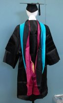 Image of 2017.008.043.42C - Graduation Hood, 1993. Long fabric hood in an elongated loop. The width of the fabric tapers from about two inches wide at its narrowest point to about two feet wide at its widest. Extending from this widest point are two extensions, one shaped like smaller, rounded tails of a coat and the other like a closed sleeve. The outside is made of a sturdy but satiny black material and a stripe of light blue velvet along one side; the inside is lined in the same satiny fabric in magenta and yellow. The hood is worn with the narrowest point at the front of the wearer's neck and the rest of the garment flowing down the wearer's back, exposing part of the inner lining and giving an impression of an elongated hood.