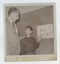 "Image of 2017.054.001.11 - Untitled [Mayor Roy Archibald with Steven Kotake in front of ""VOTE FOR PROP 1"" sign], June 12, 1968"