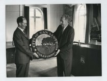 Image of 2017.054.001.17 - Untitled [Roy Archibald presenting the seal of the city of San Mateo to the Mayor of Varde, Denmark], August 19, 1970
