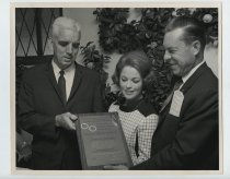 Image of 2017.054.002.12 - Untitled [Shirley Temple Black presenting award to James E. Brown], December 3, 1968
