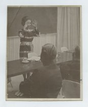 Image of 2017.054.002.3 - Untitled [Photograph of Shirley Temple Black standing behind table], October 4, 1968