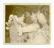 Image of 2017.054.002.31 - Untitled [Shirley Temple Black receiving Hawaiian leis], October 30, 1967