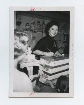 Image of 2017.054.002.37 - Untitled [Shirley Temple Black signing dolls at Macy's at Hillsdale Shopping Center in San Mateo, CA], October 26, 1957