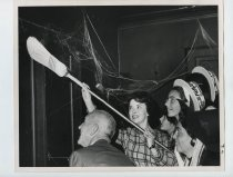 Image of 2017.054.002.4 - Untitled [Shirley Temple Black cleaning cobwebs in a haunted house in San Mateo], October 25, 1967
