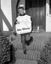 Image of 2015.001.03558.15 - San Mateo Times Paperboy Delivering Papers House to House, 1962