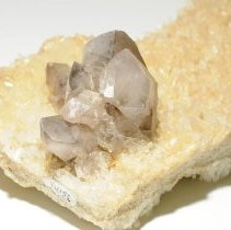 Image of Smoky Amethyst on Quartz (close view).