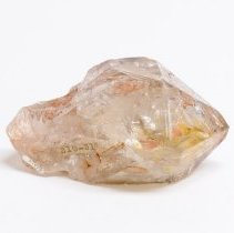 Image of Colorless Quartz crystal with red and yellow clay inclusions.