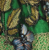 Image of 1999.47.03 sleeve flower detail