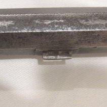 Image of X1959.06.177a-b closeup, left view, rear barrel lug.  See file marks
