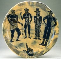 Image of platter with figures and hand