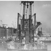 Image of B+W photo: Crane barge in dry dock area, Hoboken, no date, ca. 1940. - Print, Photographic