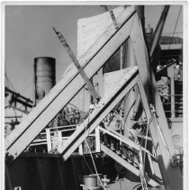 Image of B+W photo of a workman on a damaged upper deck, Hoboken, no date, ca. 1940. - Print, Photographic