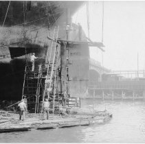 Image of B+W photo of steerage repair to an unknown ship in a dry dock south of the Lackawanna Ferry Terminal, Hoboken, no date, ca. 1922-1930. - Print, Photographic