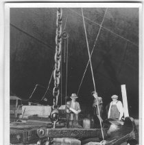 Image of B+W photo of workers working on an anchor of an unknown ship in dry dock, Hoboken, no date, ca. 1940. - Print, photographic