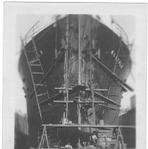 Image of B+W photo of a heads-on view of bow repairs to the S.S. Norfolk in dry dock, Hoboken, no date, ca. 1940. - Print, photographic