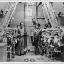 Image of B+W photo of 2 men in engine room of unknown vessel, Hoboken, no date, ca. 1940. - Print, photographic