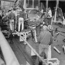 Image of B+W photo showing workers repairing damage on the main deck on unidentified vessel at Bethlehem Steel Shipyard, Hoboken Division, no date, ca. 1940. - Print, photographic