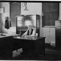 Image of B+W photo of supervisor sitting at desk in drafting room, United Dry Dock Co., Hoboken, 1931 - Print, photographic