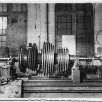 Image of B+W photo of low pressure turbine rotor of the S.S. Bonheur on a lathe, machine shop, Hoboken, Jan., 1938. - Print, Photographic