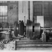 Image of B+W photo of low pressure turbine rotor of the S.S. Bonheur on a lathe, machine shop, Jan., 1938. - Print, Photographic