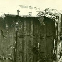 Image of B+W photo of another closer view of major damage to an unidentified freight vessel in dry dock, possibly in Hoboken, no date, ca. 1940. - Print, Photographic
