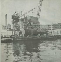 Image of back cover; view of Bethlehem Steel pier 1 with crane; Maxwell House
