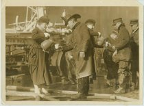 Image of Sepia-tone photo of 2 Red Cross volunteers providing coffee to firemen at the Admiral Benson Club fire, Hoboken, Dec. 15, 1919. - Print, Photographic