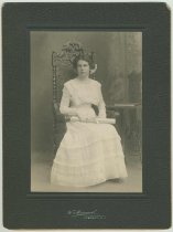 Image of Photo of Florence or Madeline Miller, ca. 18 years old, seated in a chair at the photographer's studio, Hoboken, no date, ca. 1905-1910. - Print, Photographic