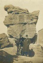 Image of Photo postcard of probably Mary Henry Markey on a burro with Frank P. Markey at a tourist site in the American West, December, 1917 - Print, Photographic