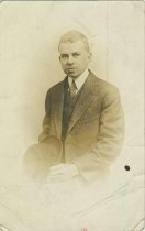 Image of Photo postcard of an unidentified young man in suit, no place, no date, ca. 1900-1910. - Print, Photographic