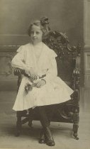 Image of Photo of Florence Miller, ca. 10 years old, posing in a chair at the photographer's studio, Hoboken, no date, ca. 1890. - Print, Photographic