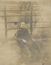 Image of Sepia-tone photo of Mrs. Annette Henry seated in a rocker in the backyard of 716 Bloomfield St., Hoboken, no date, ca. 1890. - Print, Photographic