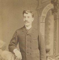 Image of Sepia-tone photo portrait of Father Ferretti posed in a photographer's studio, Hoboken, no date, ca. 1890. - Photograph, Cabinet