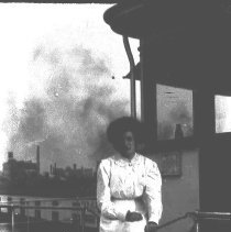 Image of B+W negative image of an unidentified woman near what appears to be the wheelhouse of a ferry, dayliner or coastal steamer, no place, no date, ca. 190 - Negative, Film