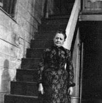 Image of B+W negative image of Mrs. Annette Henry standing near the backyard stairs, no place, no date, ca. 190 - Negative, Film