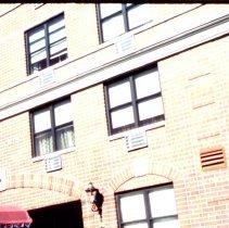 Image of Color slide of building under renovation on or near Newark and Garden Sts., Hoboken, ca. 1984. - Transparency, Slide