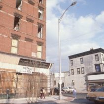 Image of Color slide of buildings under renovation on or near First and Clinton Sts., Hoboken, ca. 1983-84. - Transparency, Slide