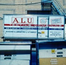 Image of 27 truck A.L.U. Textile Combining Corp. of 208 Clinton St.; gas pumps