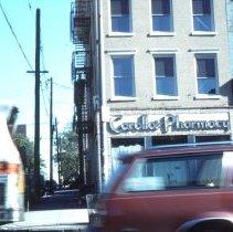 Image of Color slide of the former Carollo's Pharmacy, 425 Washington St., corner of Fifth Street, Hoboken, November, 1983. - Transparency, Slide