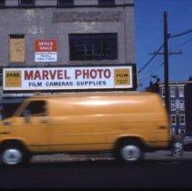 Image of Color slide of the storefront of Marvel Photo, 134 Washington St., Hoboken, 1983. - Transparency, Slide