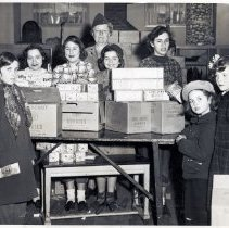 Image of B+W photo of Hoboken Girl Scouts preparing for annual cookie sale, Hoboken, 1950. - Print, Photographic