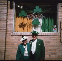 Image of Color photo of woman and man in Irish dress posed outside Shannon Lounge, First St., Hoboken, n.d, ca. 1980-1985. - Print, Photographic