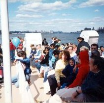 Image of Color photo of the passengers on Hudson River ferry looking north, Hoboken 1989. - Print, Photographic