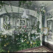 Image of Lantern slide, color, of a floral decorated interior, used for promotional display in Hoboken, no date, ca. 1920. - Transparency, Lantern-slide